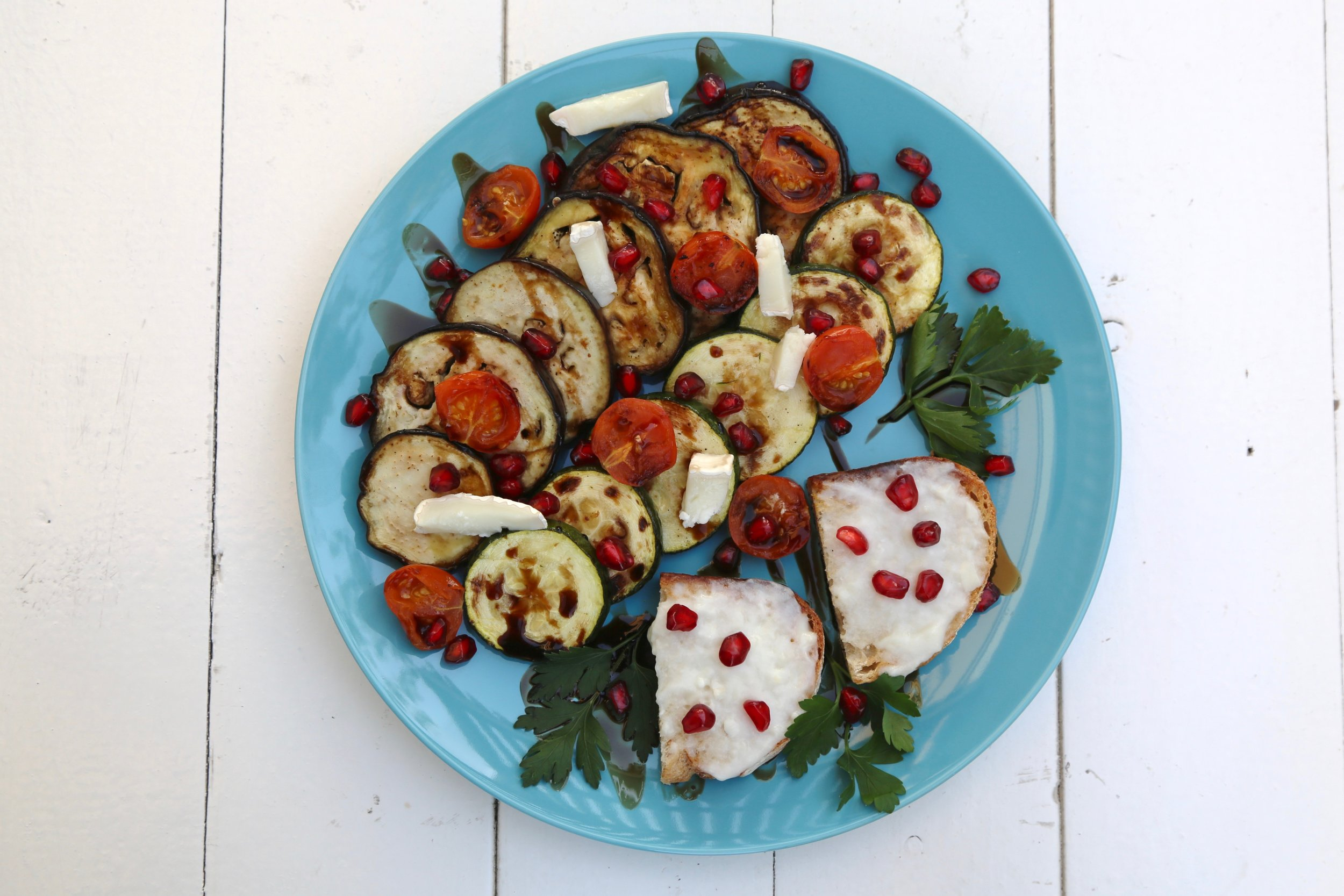 Grilled Vegetables: Zucchini, eggplant, cherry tomatoes, with goat cheese tartines on the side