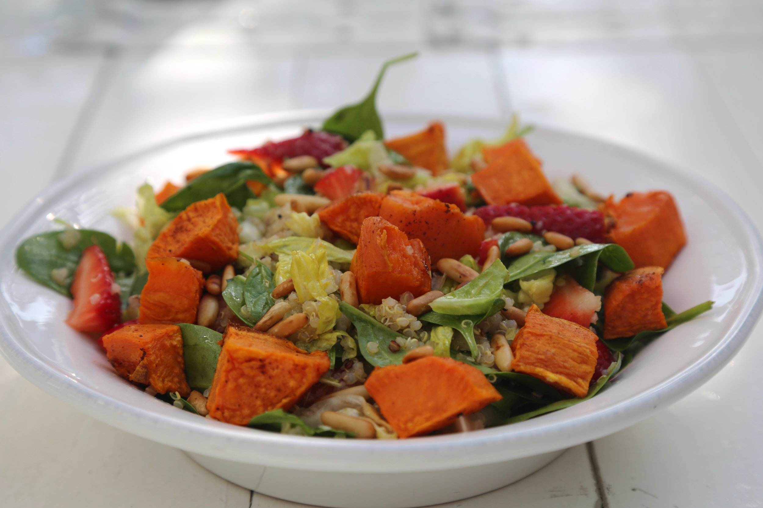 Sweet Potato & Quinoa Salad: Lettuce, spinach, sweet potato, strawberry, pine nuts with lemon dressing