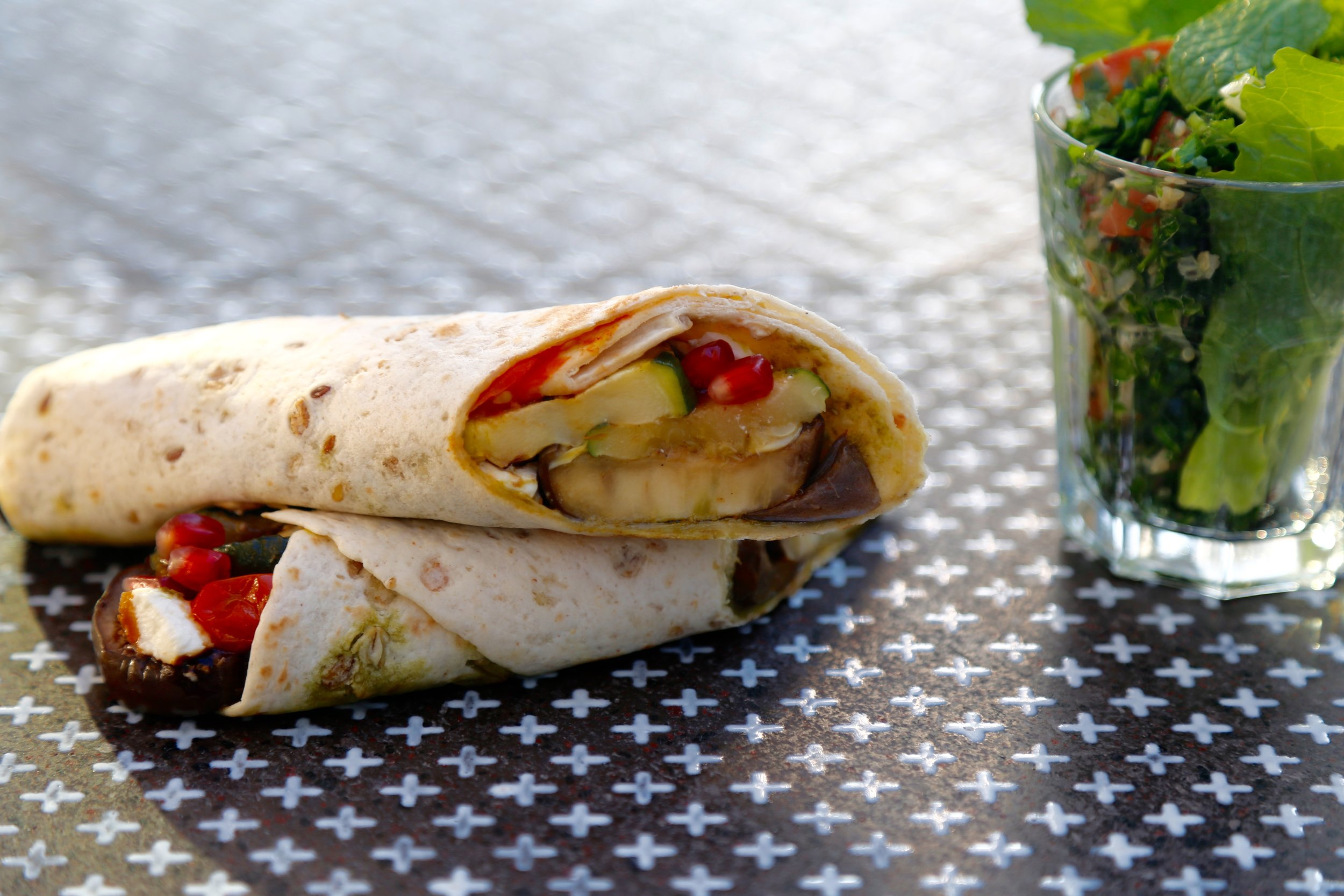Veggie Wrap: Grilled zucchini, eggplant, tomatoes and feta cheese served with tabbouleh salad