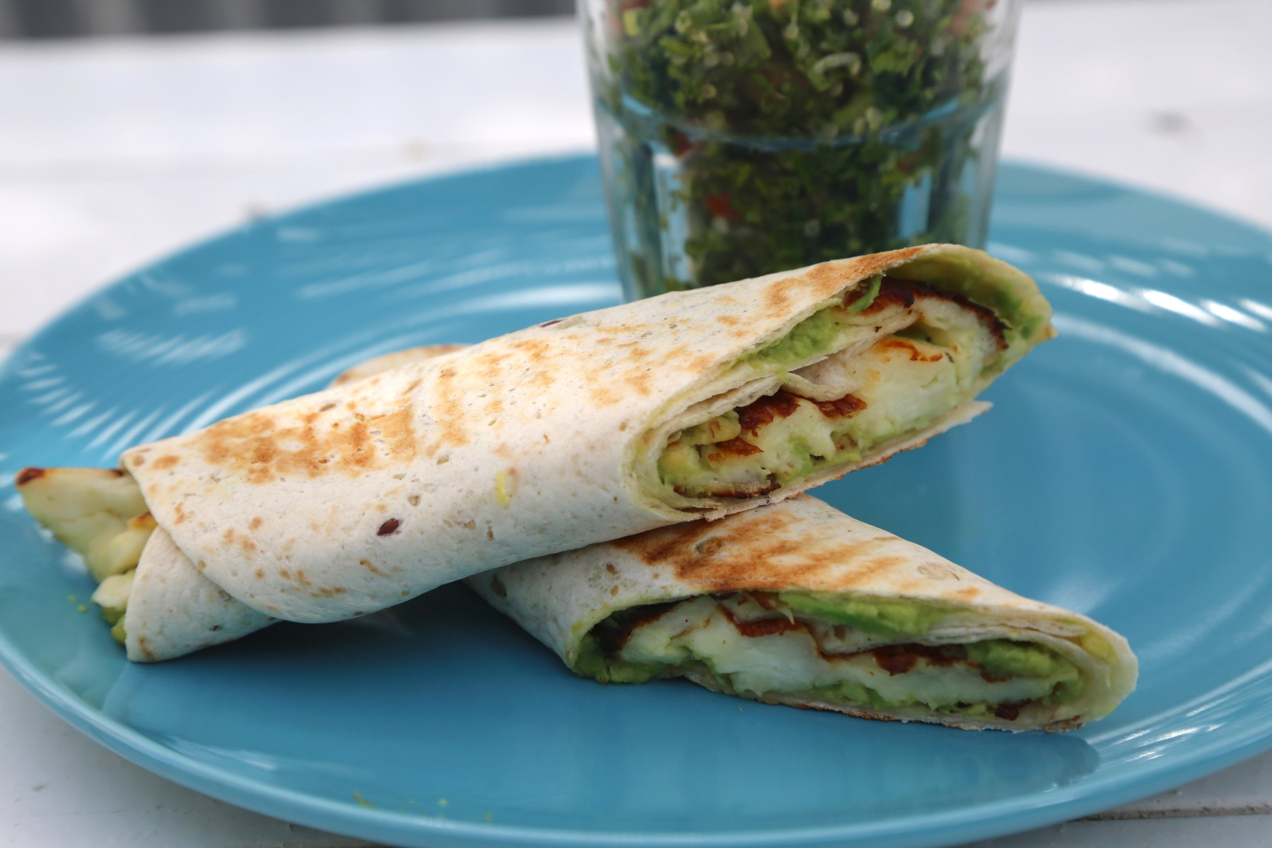 Halloumi Avocado Wrap: Grilled halloumi and mashed avocado served with tabbouleh salad