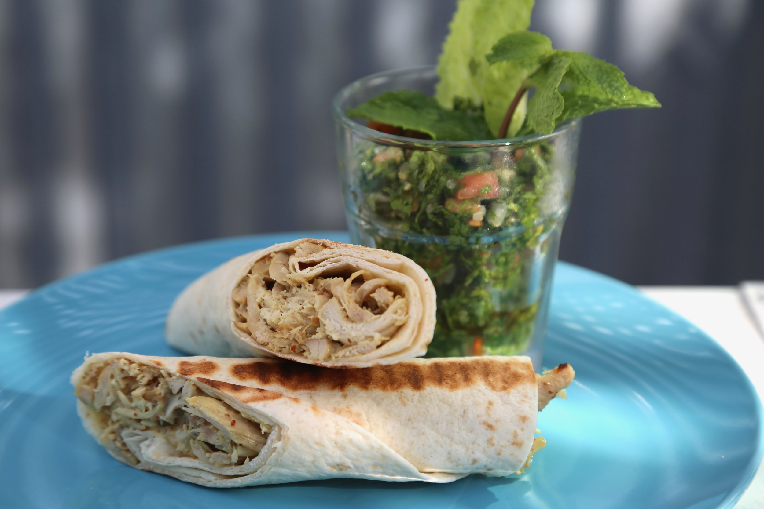 Chicken Wrap: Barbecued chicken in yogurt sauce flavoured with mango chutney and mustard, tomato, cucumber, lettuce and served with tabbouleh salad