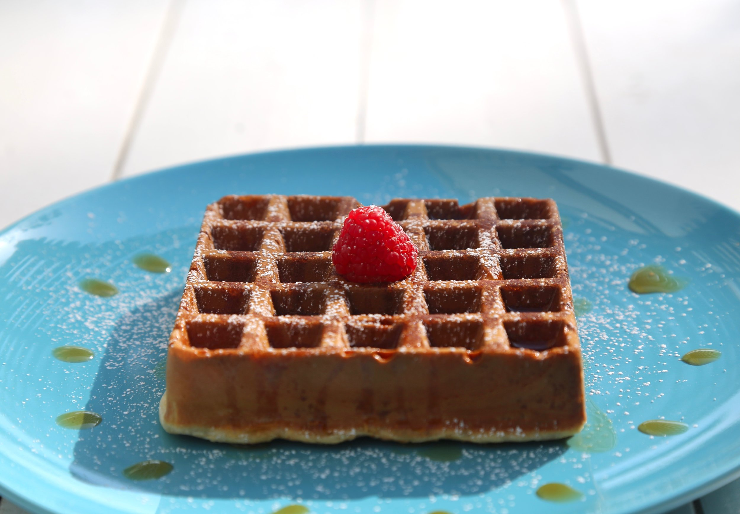 Waffles: Sugar dusted or maple syrup on the side