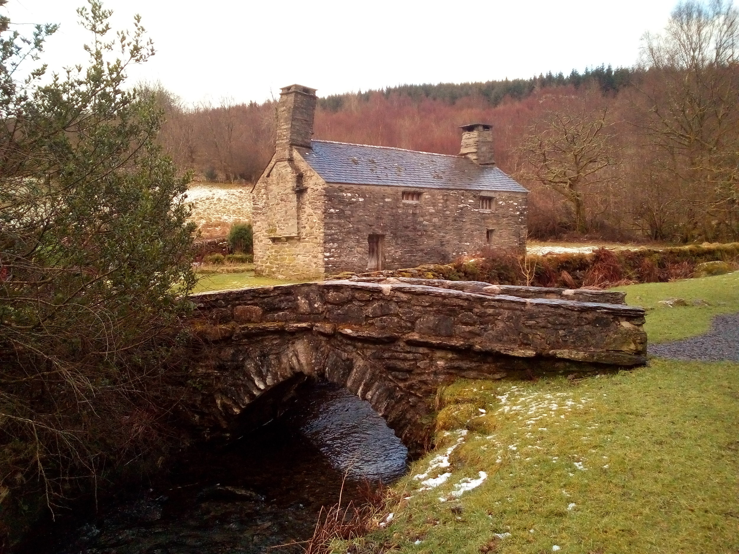 View of the historical farmhouse from the powerhouse.