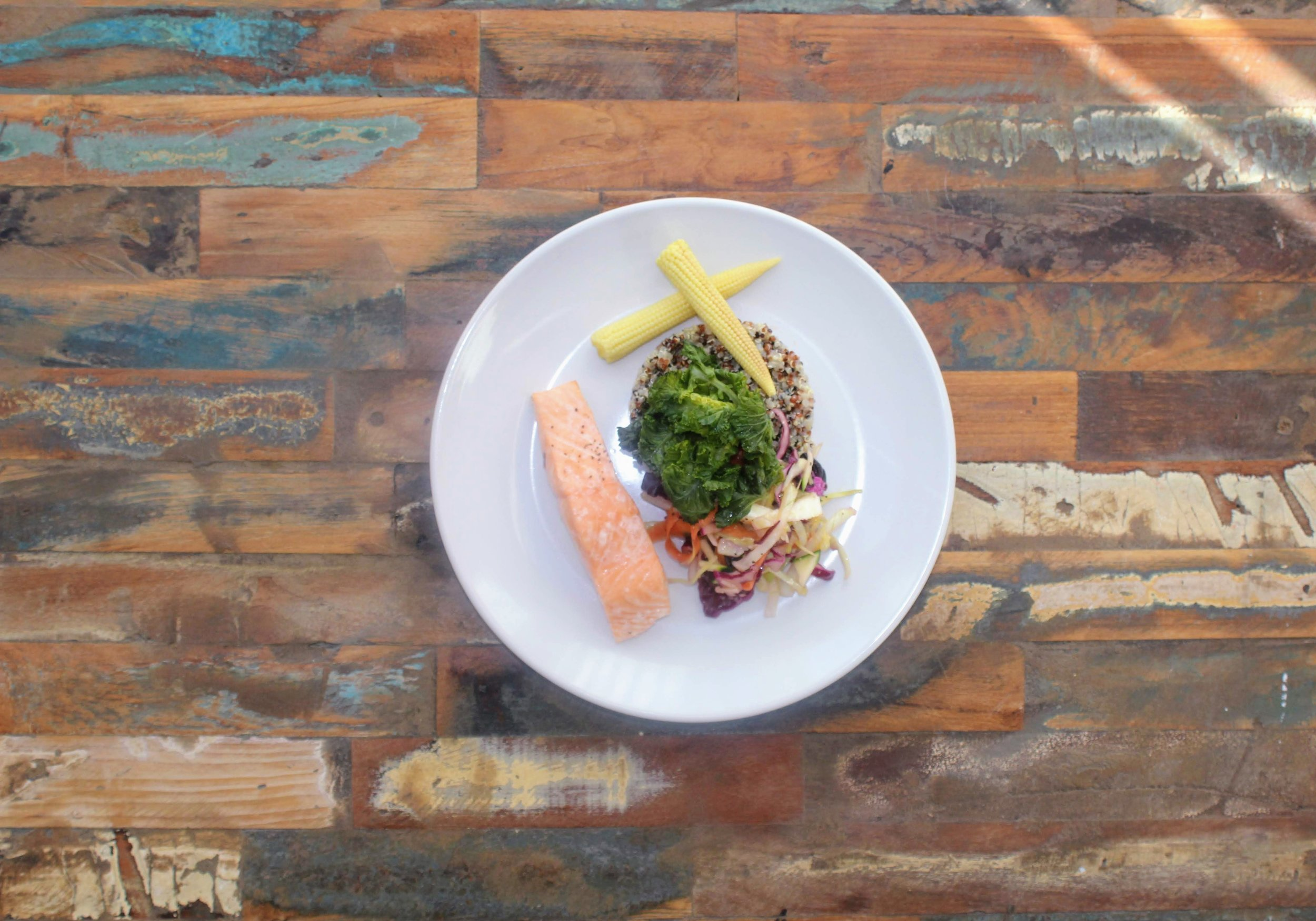 Poached salmon with quinoa and veg