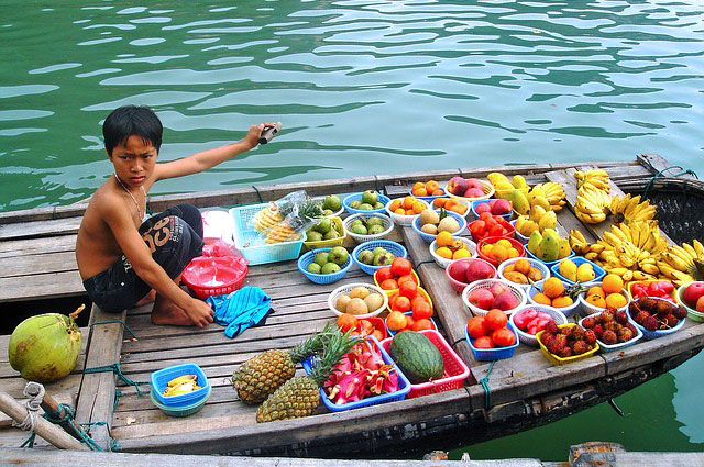 Vietnamese kid selling fruits in Hanoi- Varsha Rao Exploring Asia