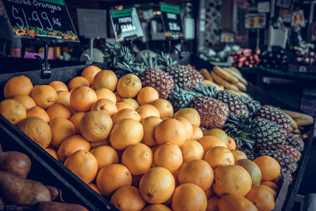 Fresh oranges and pineapples at South Melbourne Market