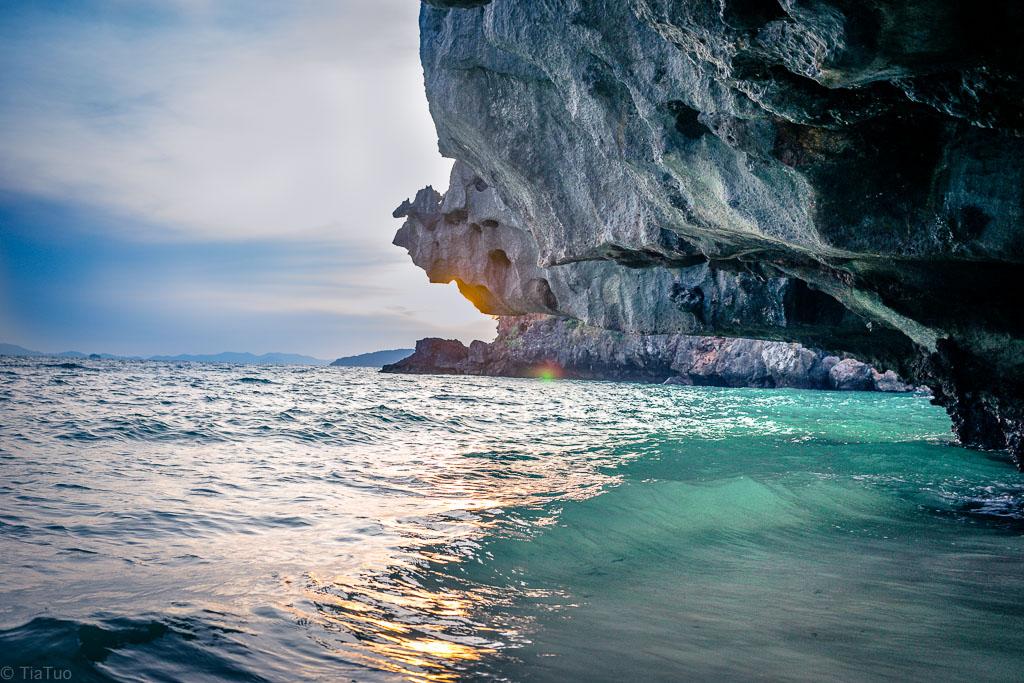 Sun setting behind limestone cliffs