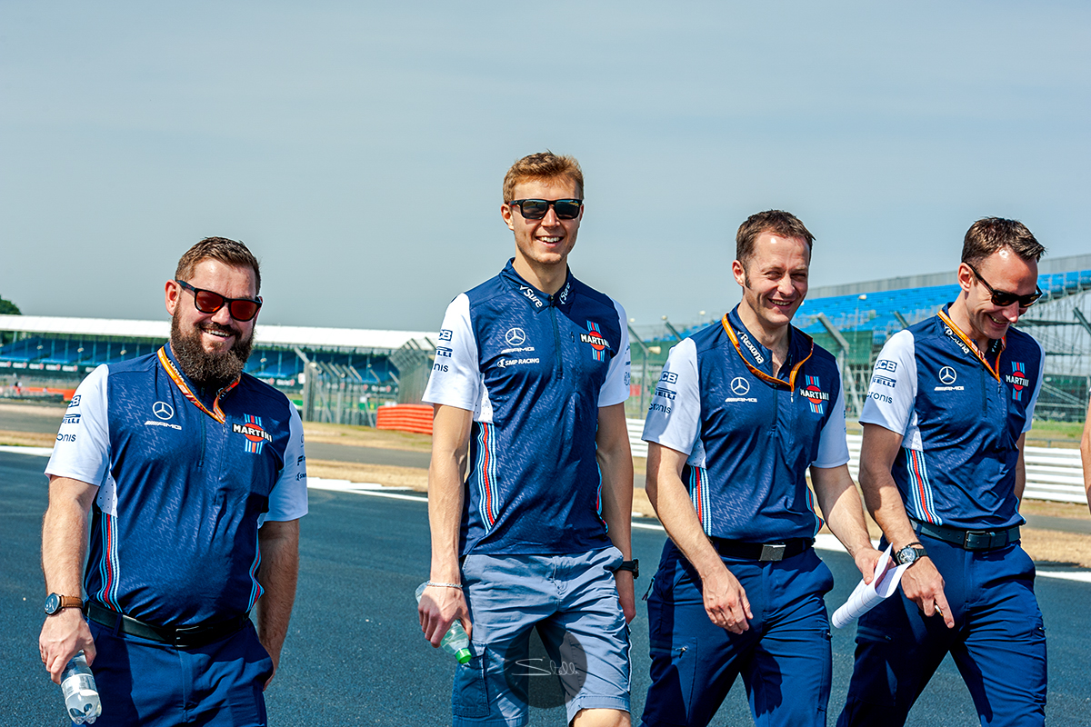 Sergey walks the Silverstone circuit on Thursday morning with his engineers