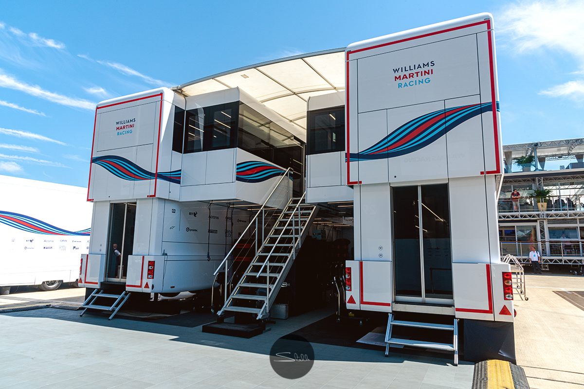 The team's engineering trucks which house offices, tyres and consumables