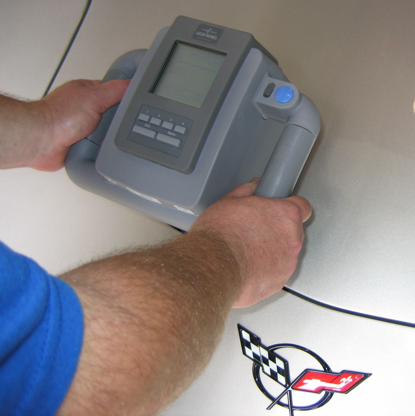"Custom or non factory colors are matched using our in house camera, ""the AQUIRE RX"" that actually identifies the colors on an existing finish and transmits that data to the formula retrieval system which then adjusts the color to a precise formula for mixing. Although this technology has existed foryears, Dupont has been a pioneer with advancing the accuracy of these units. Previous models only identify 6 paint angles while this unit will identify over 12 and the only system that adjusts the formula versus matching it to a ""close"" variant.. Having this truly state of the art equipment in house really gives us a distinct advantage over virtually all other shops saving time and preventing multiple coats that have been applied in error."