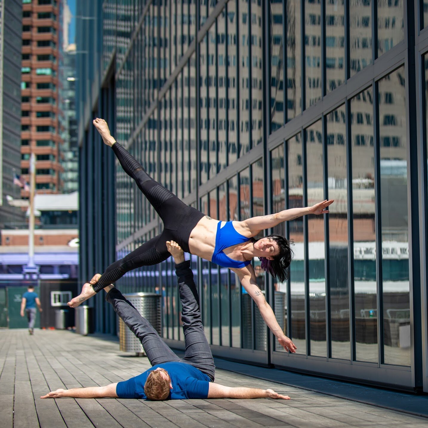 Emily's movement practice combines yoga, dance, partner acrobatics, flexibility training, and handstands with her knowledge of physiology and body mechanics.