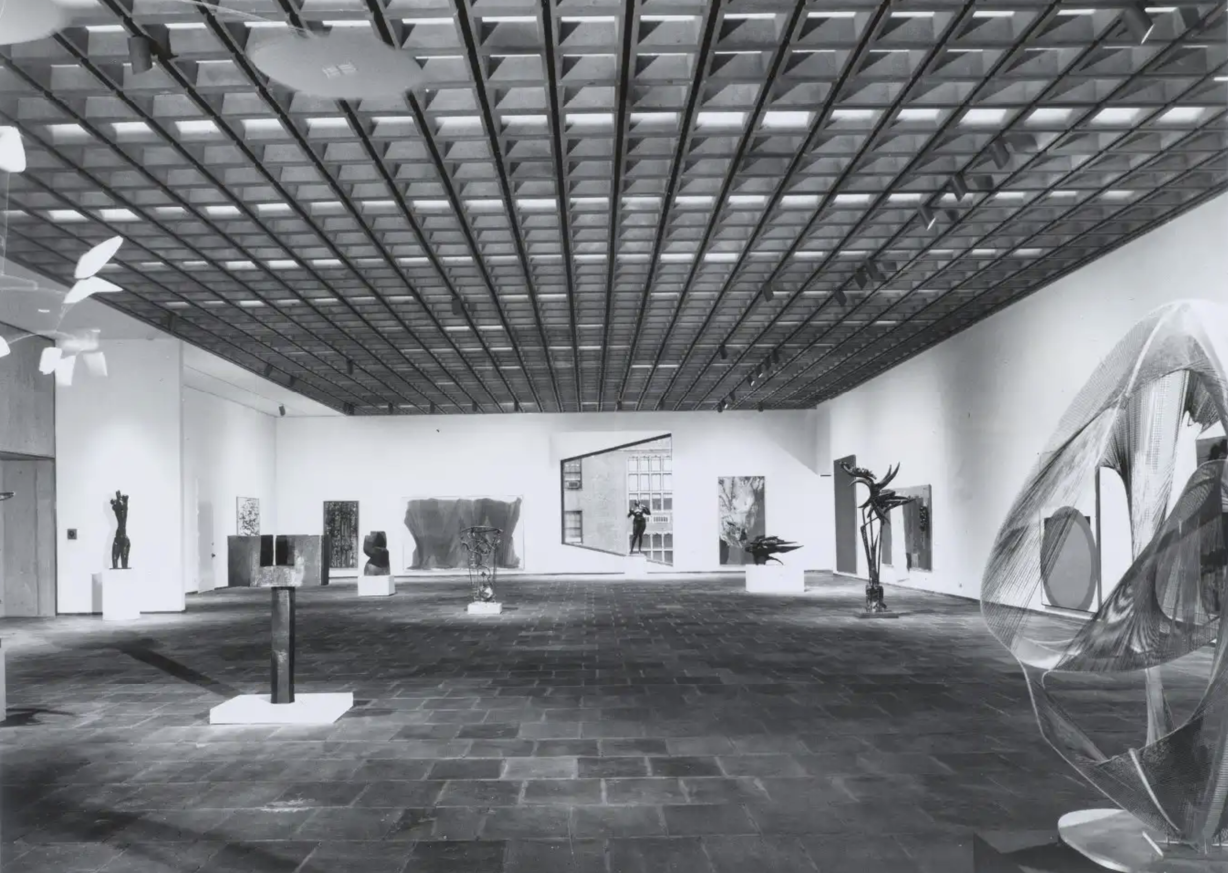 Fourth floor gallery showing suspended concrete grid ceiling
