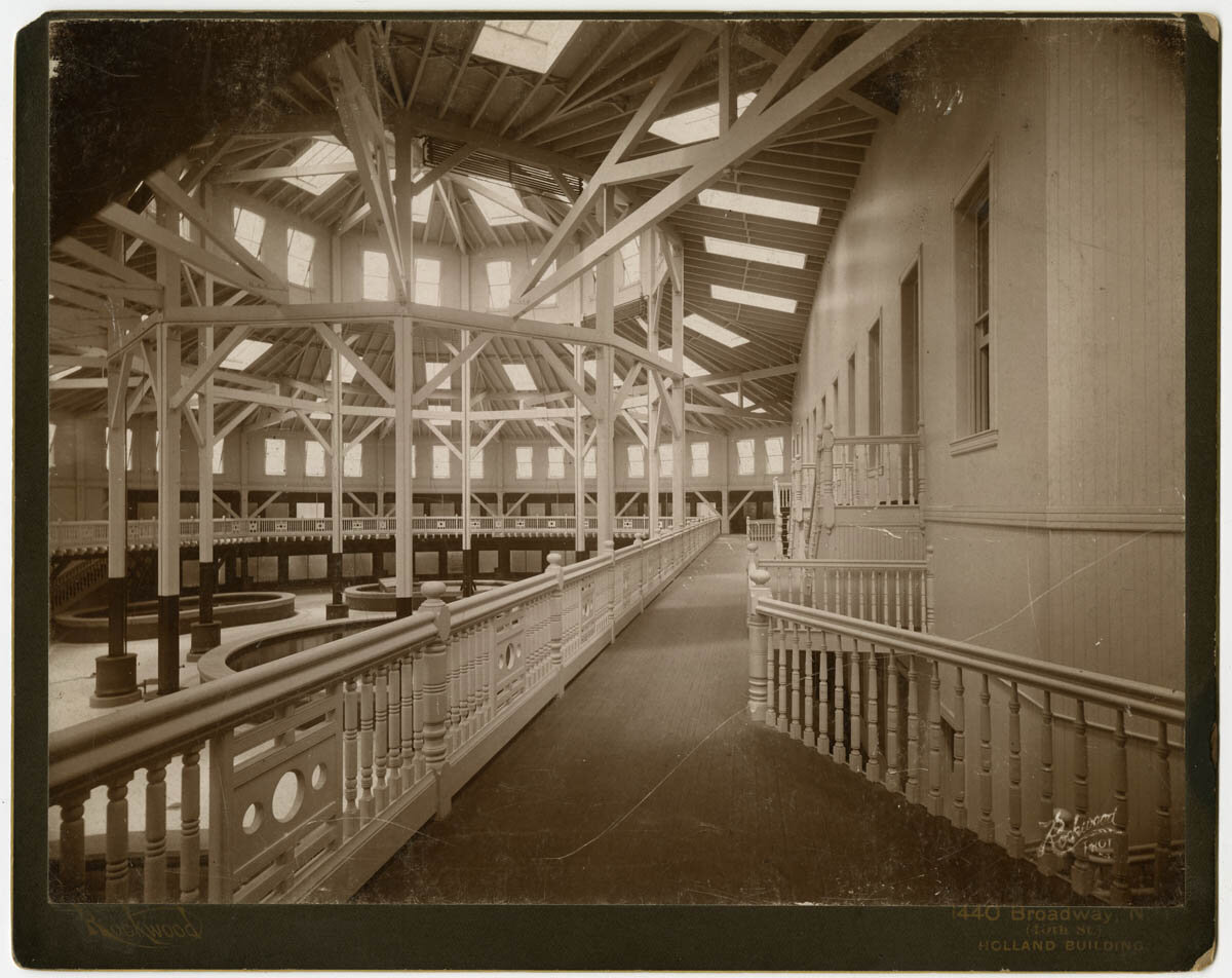 Balcony and interior of the New York Aquarium, showing tanks and skylights