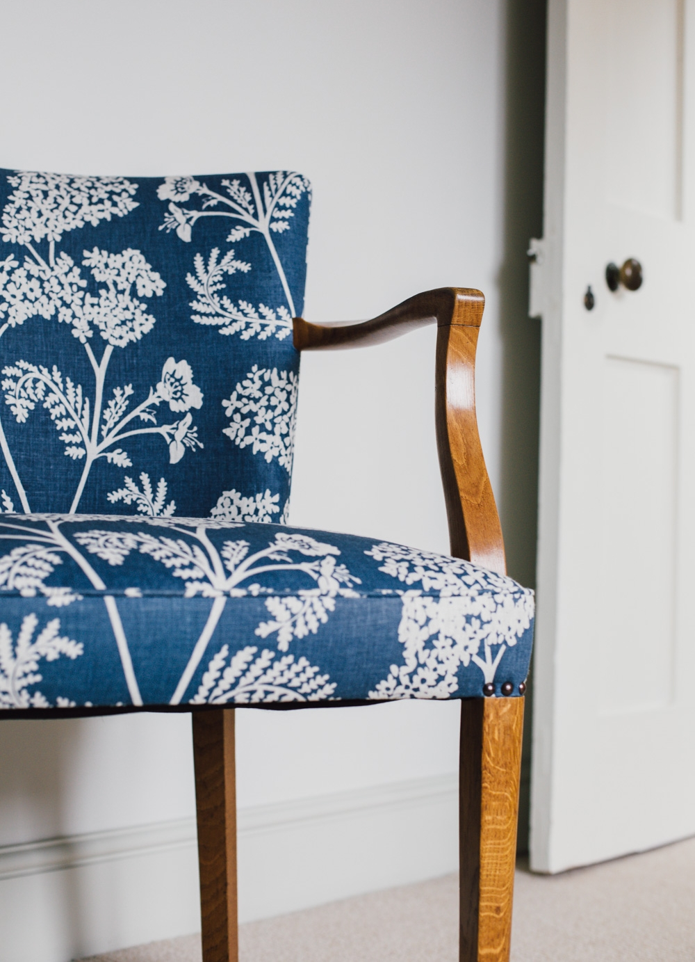 Achillea ground large in Burghley blue on natural linen.