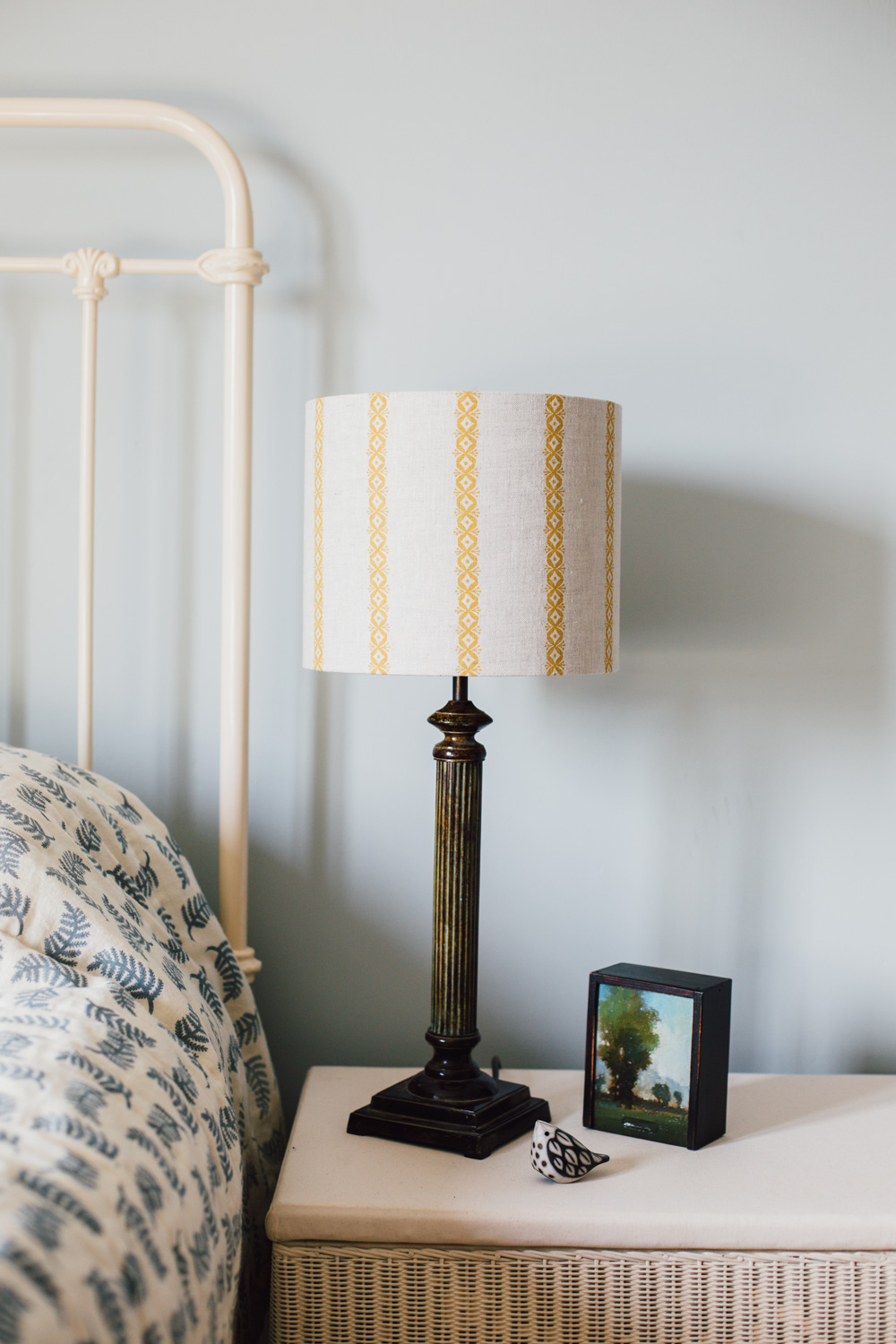 On the lampshade, blossom stripe in Hay on natural linen.