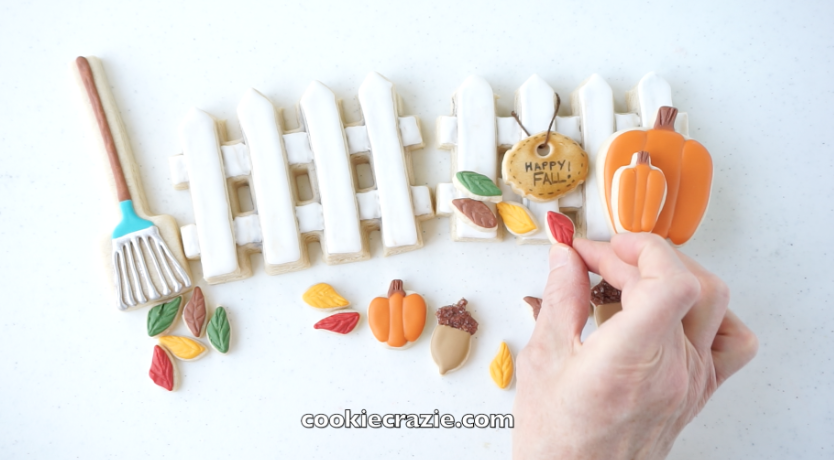 Build a little autumn scene with mini pumpkins, leaves, acorns and even a rake cookie.