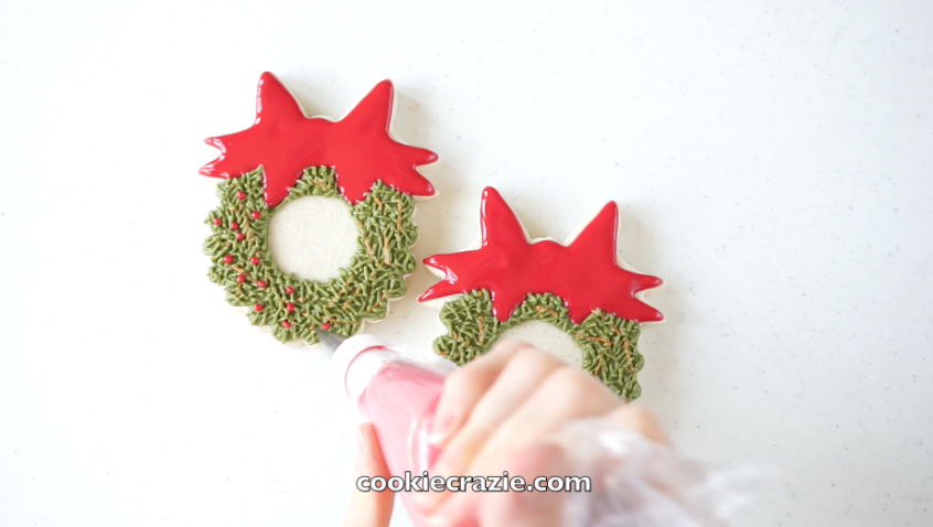 Add red dots to the wreath to represent berries.
