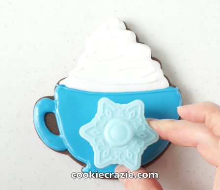 When the timer that you set [after flooding the base of the mug] goes off, use a plunger/cutter like  THIS ONE  or  THIS ONE  or a mini cookie cutter to emboss the front of the mug as shown on the photos/video.