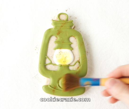 Brush dry caramel dust lightly over the entire lantern to give it an aged-look. (Dust found  HERE )