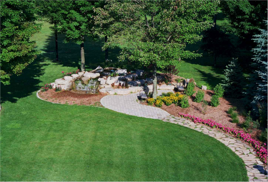 We added function and interest to this lawn with a stone pathway to an inviting garden.