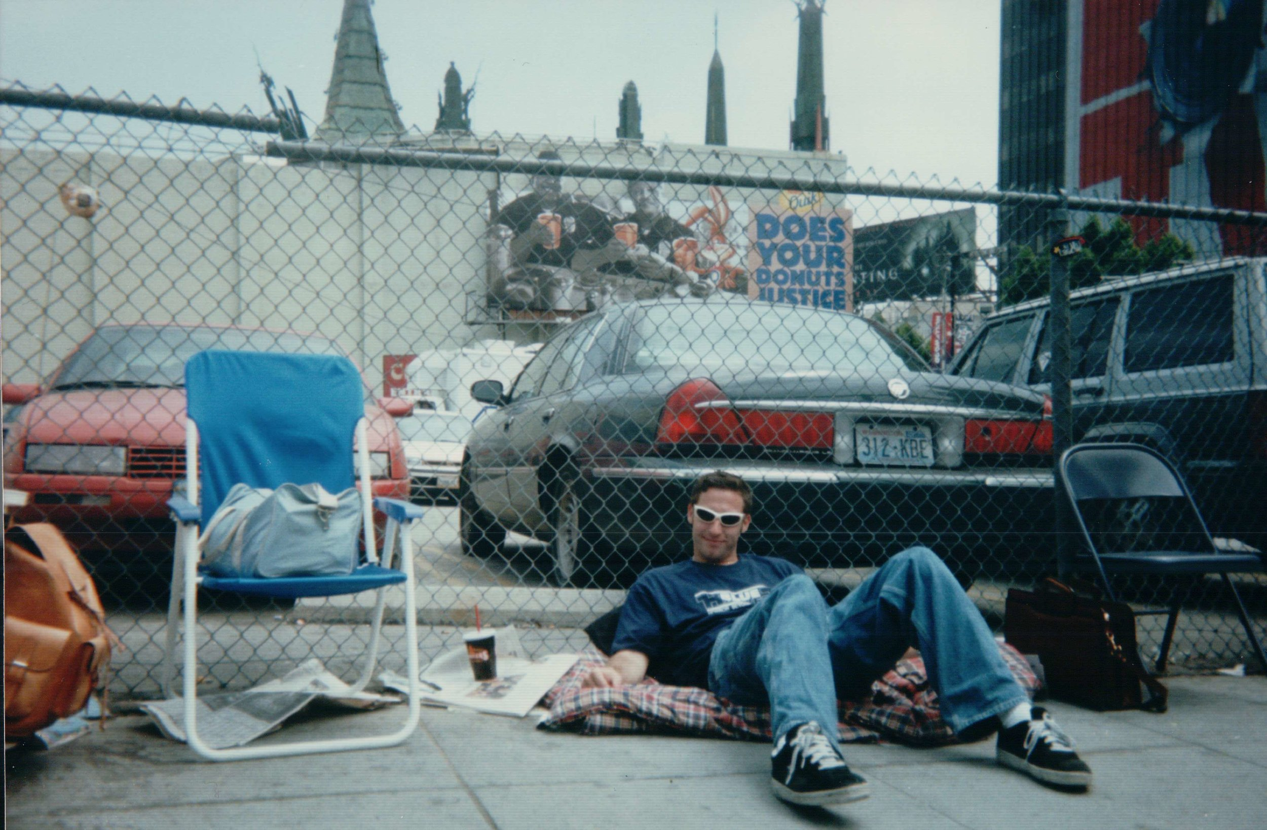 Brennan Swain waits in line at Grauman's Chinese Theatre in Hollywood on opening day - May 19th, 1999.