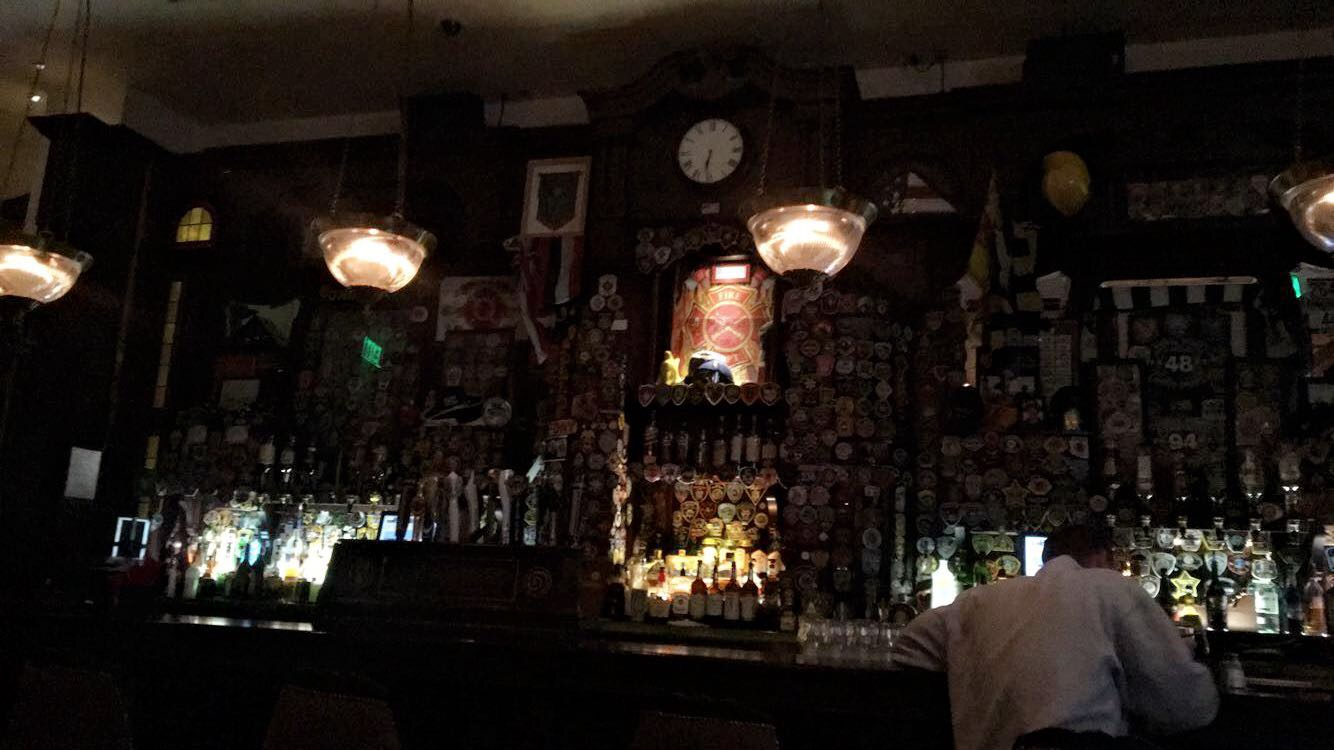 """This Irish Pub had a very """"Haunted Mansion"""" a la Disney vibe with floating statue heads but their bar was pretty cool. The salmon was so good that it didn't last long enough to get a picture."""