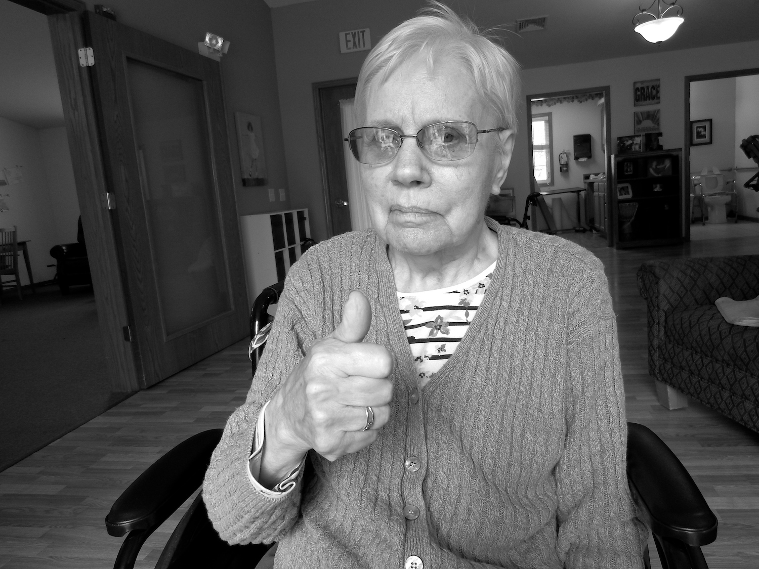 seniors home resident gives a thumbs up