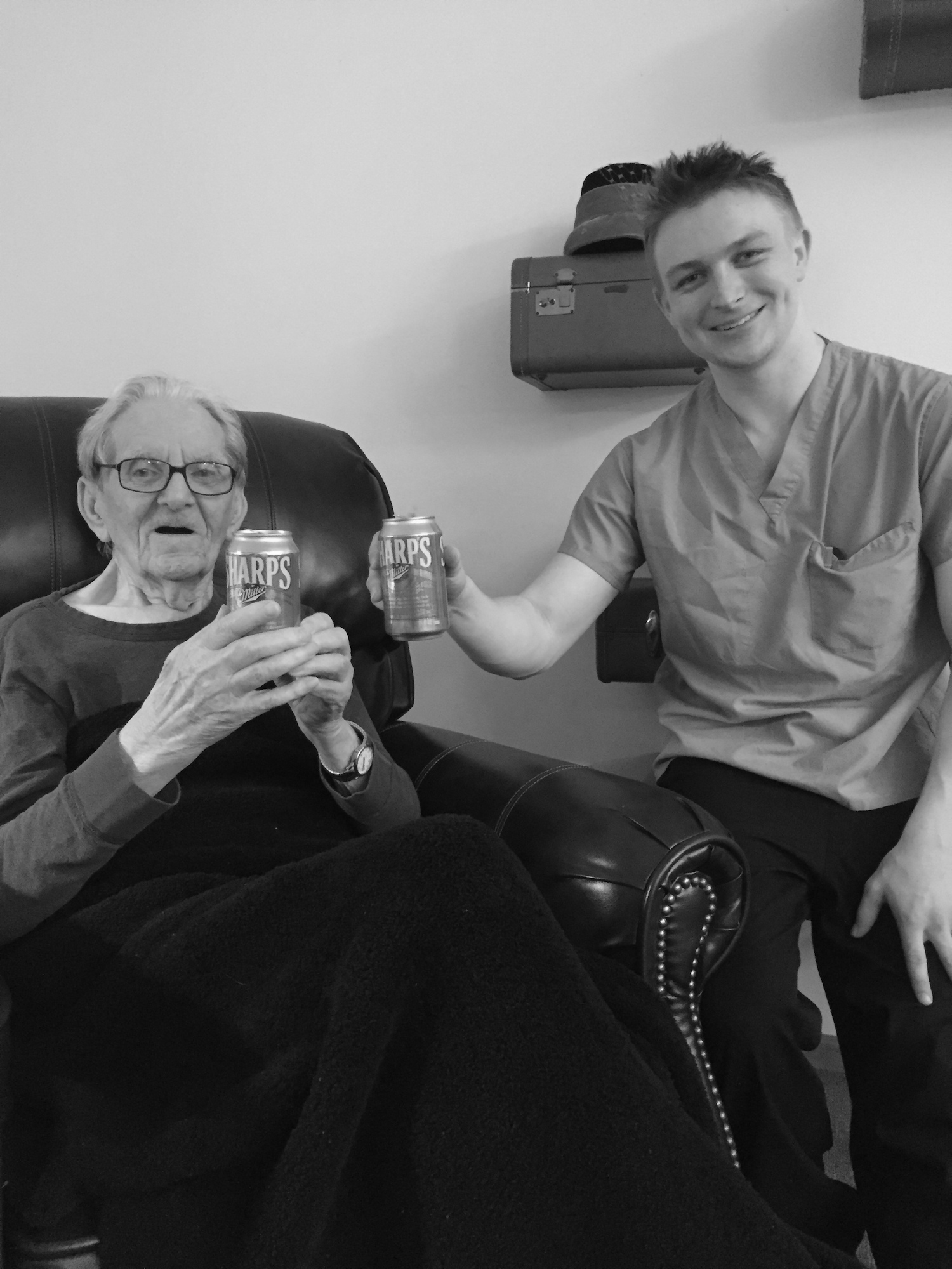 Memory care resident drinks a beer with companion