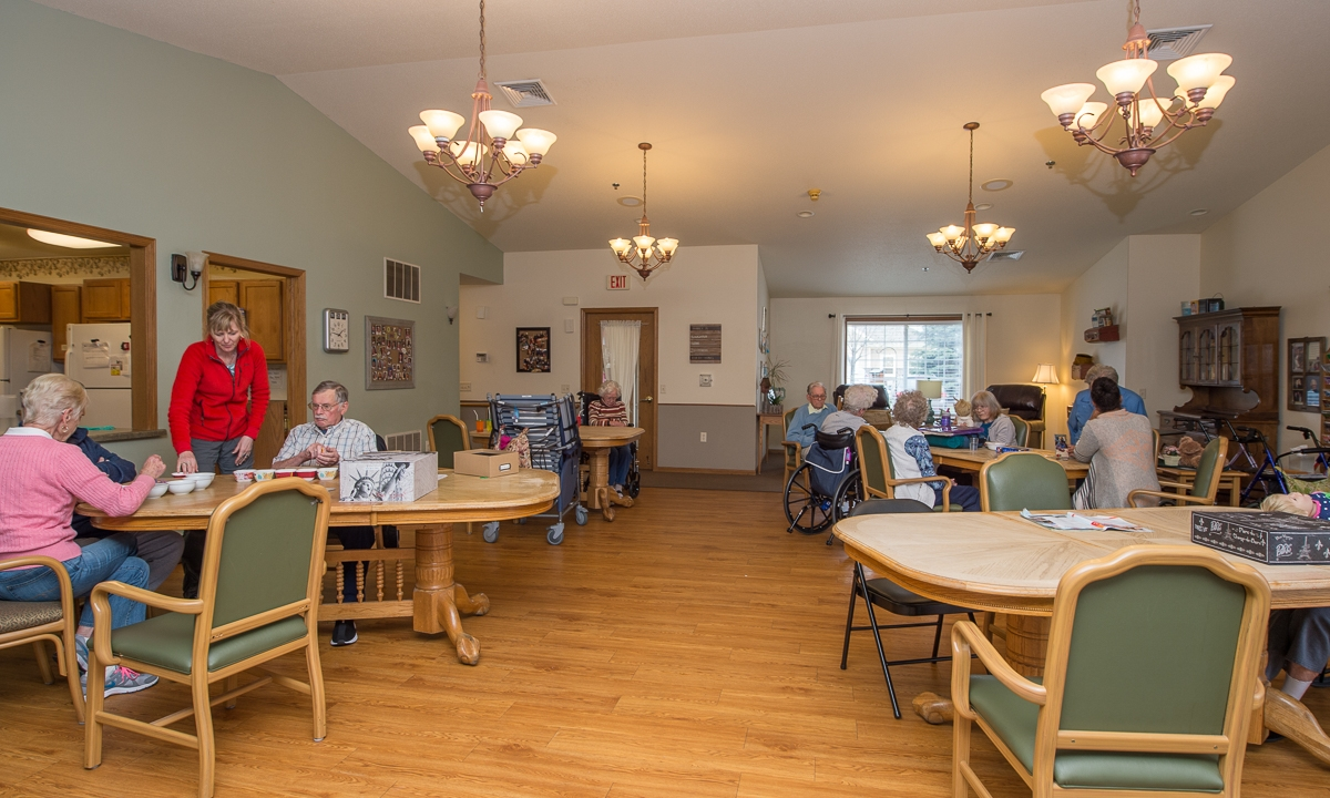many senior residents sit around the common area