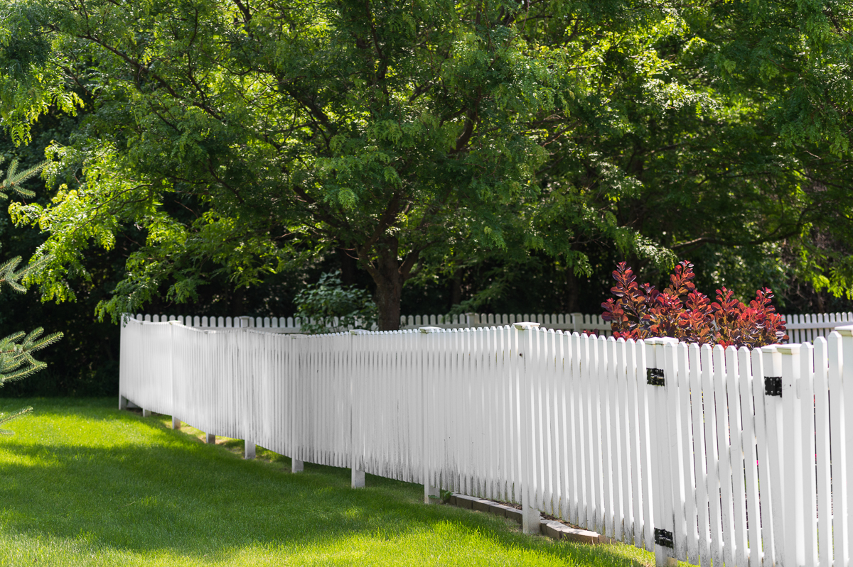 White picket fence with greenery around at a seniors home