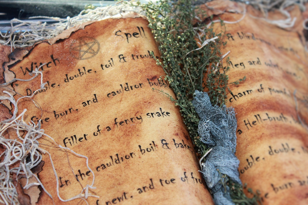 Book of death (spells and pagan rituals). Photo by  Amber Avalona