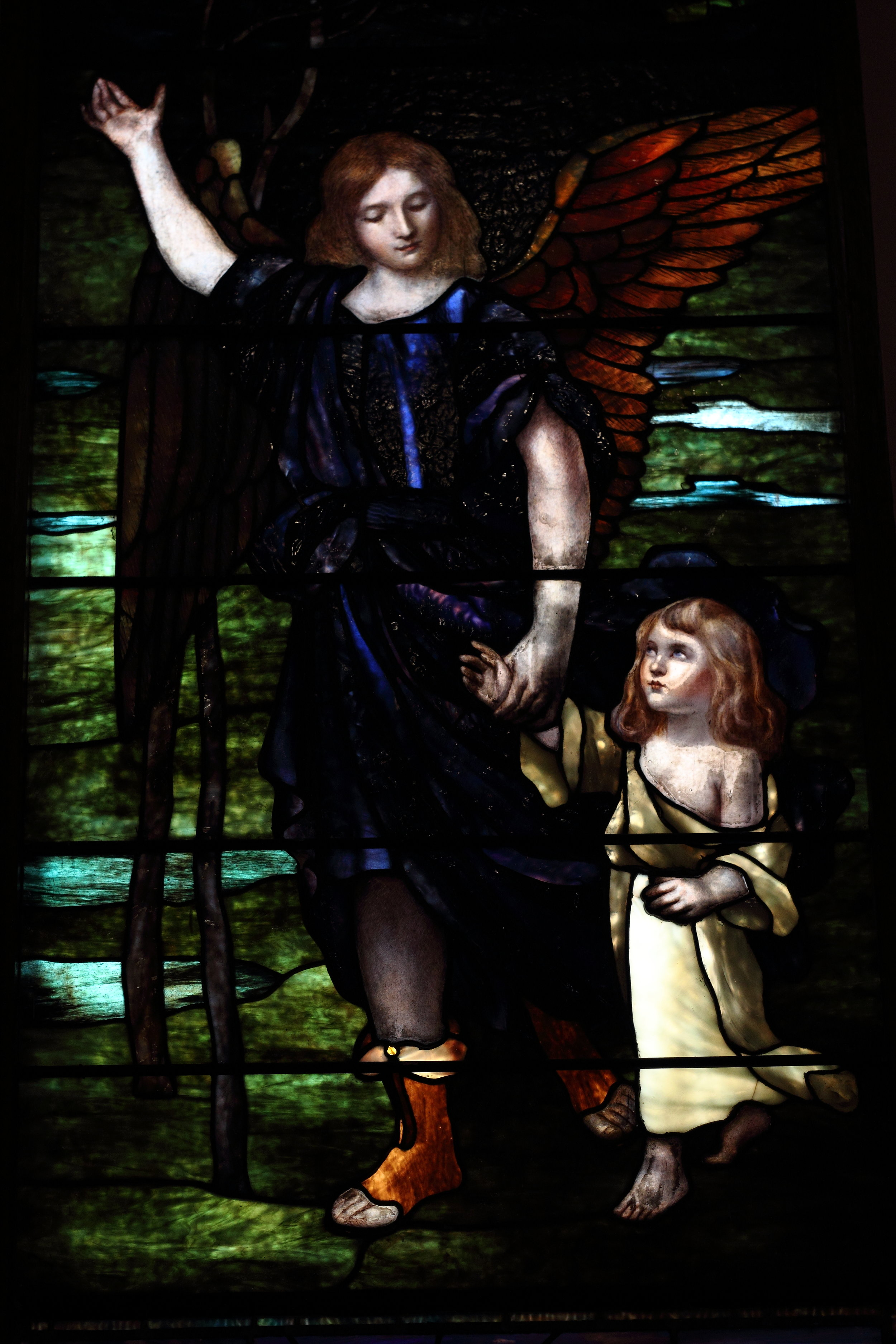 One of Emmanuel's stained-glass windows depicts a child being guided by an angel. Photo by Ashton Pilkerton.