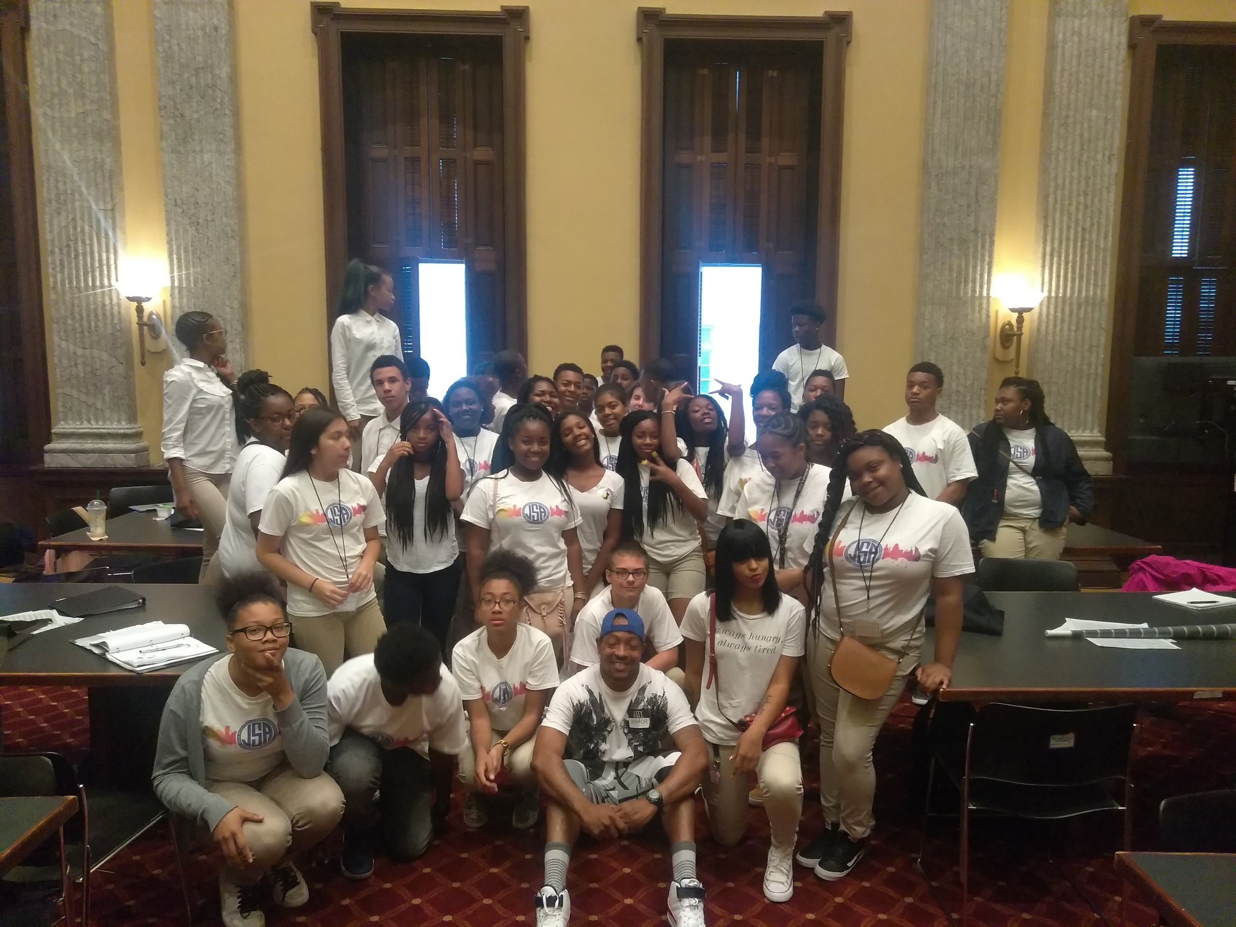 HOPE leader Antoin Quarles with youth from City Hall Urban Community Development to Relieve Barriers