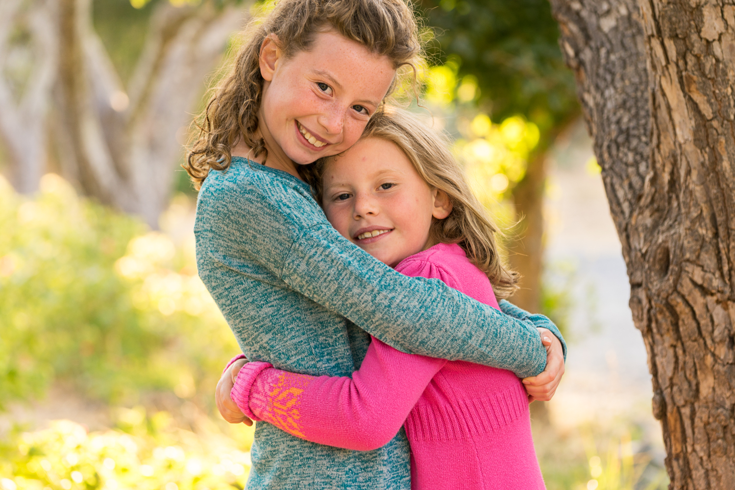 two sisters hugging in the park-San Ramon children's photography