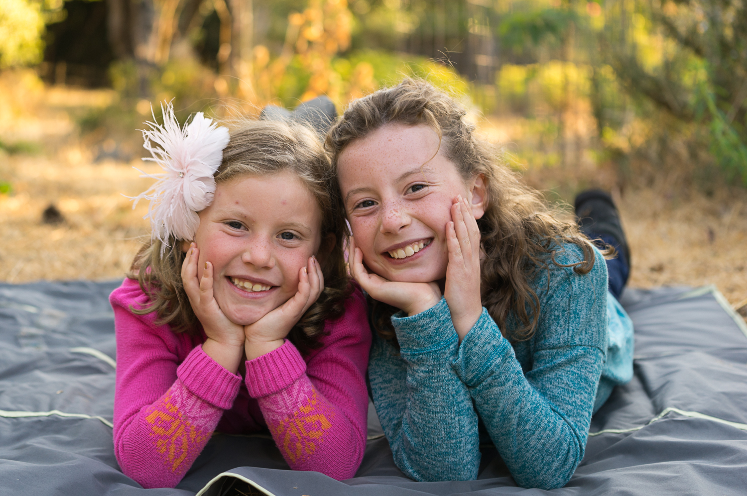 sisters smiling in the park-San Ramon natural light photographer