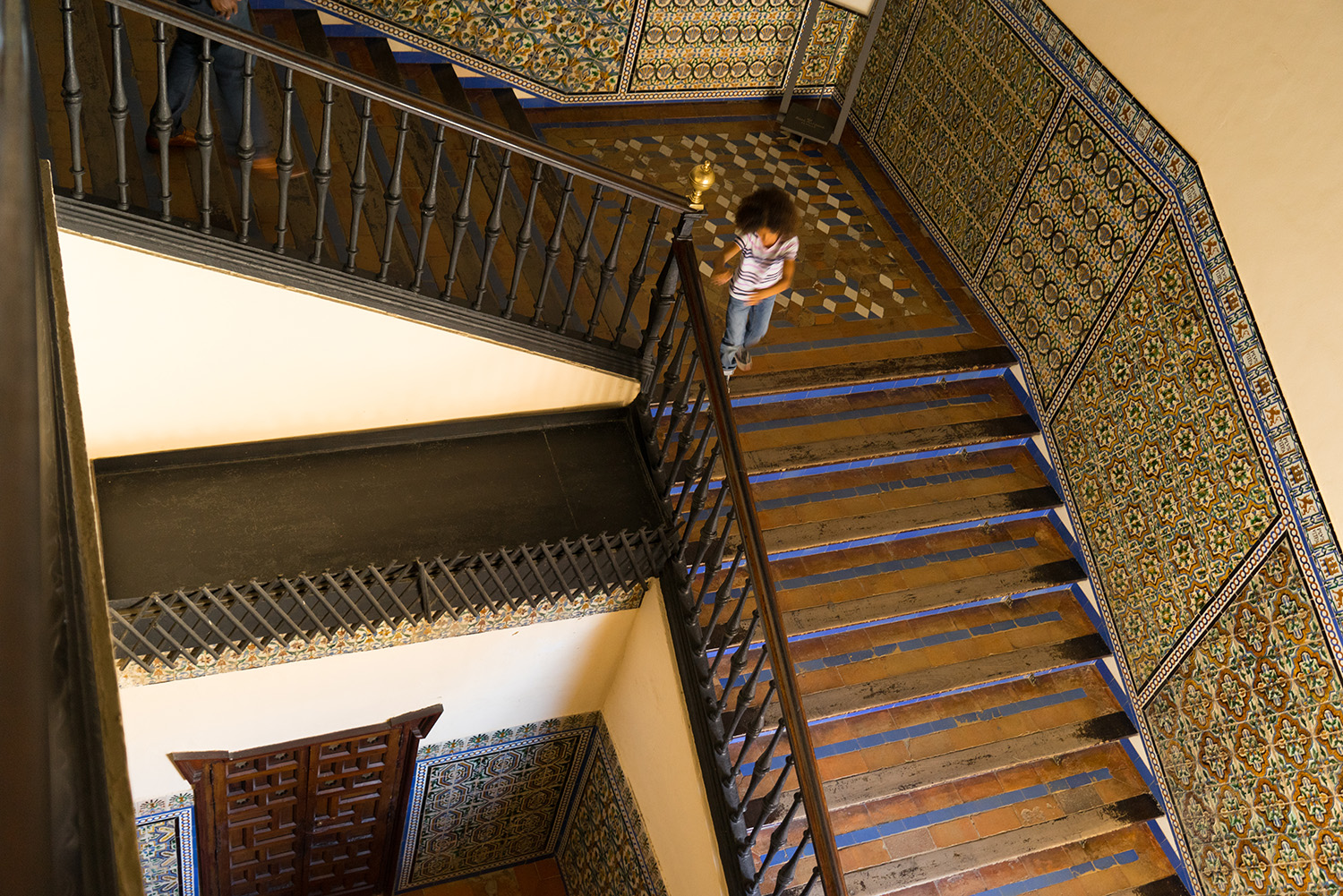 girl running down staircase-lifestyle photos