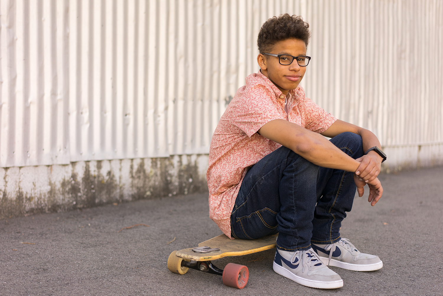 high school senior sitting on skateboard-Danville lifestyle photographer