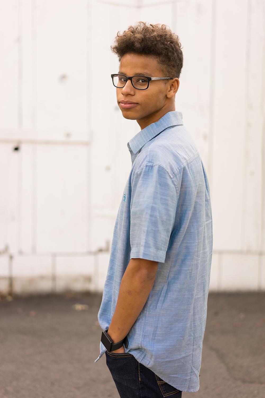 high school senior turning to look at camera-Danville portrait photographer