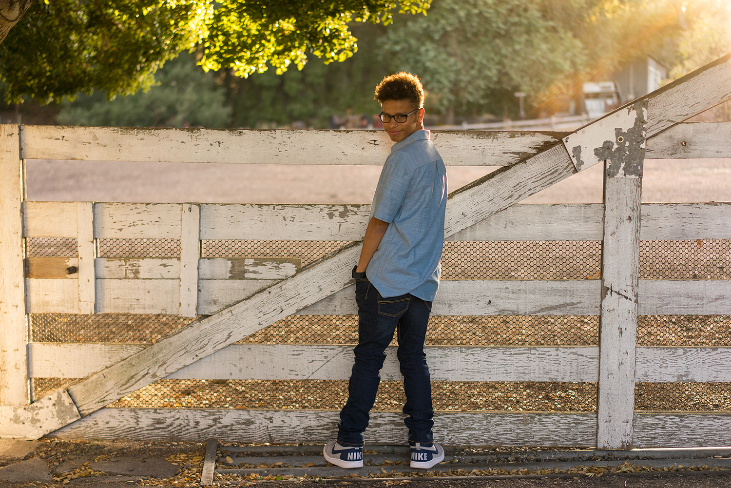 seventeen year old in front of fence-SRVHS senior photographer