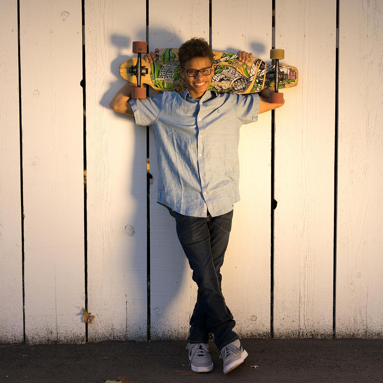 high school graduate with skateboard-Danville senior photographer