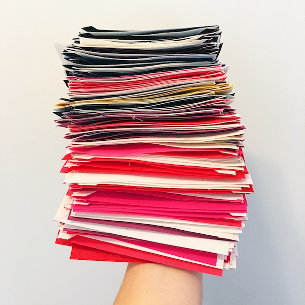 Stack of pink/red half-square triangles