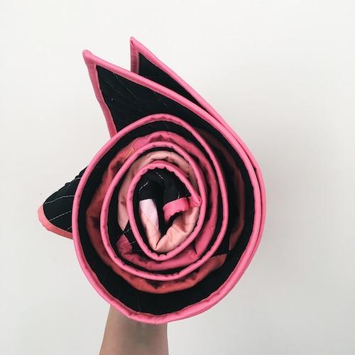 Pink binding quilt roll