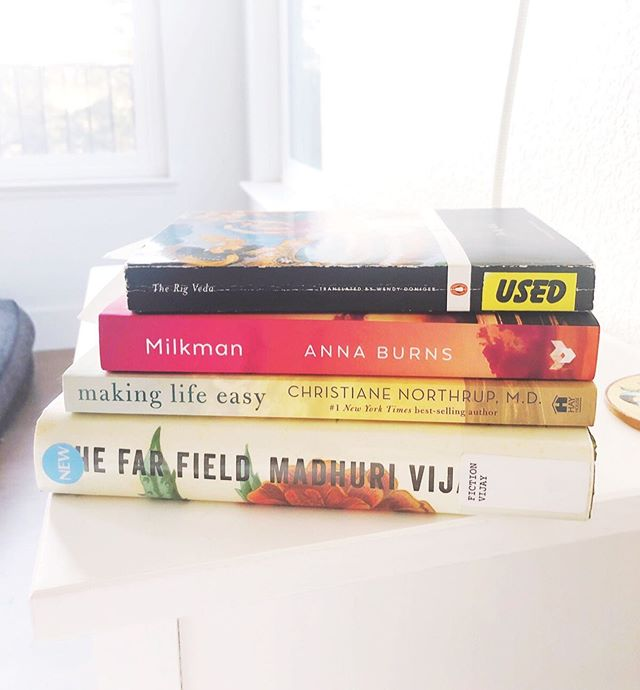 There's nothing more comforting than a good book...or four.😂 Raise your hand if you can't just read one book at a time.🙋‍♀️ . . These are the books that are currently keeping me company: 'The Rig Veda'—Translated by Wendy Doniger 'Milkman,'—Anna Burns 'Making Life Easy,'— @drchristianenorthrup 'The Far Field,'— Marhuri Vijay . . What books are you reading?