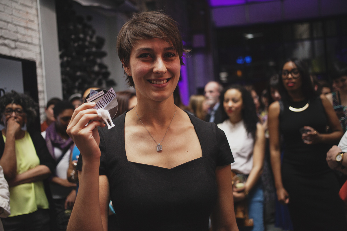 Beah Burger-Lenehan, VP of Product, at Ticketleap proudly displays her Rad Award for Technologist of The Year. April 18. 2015. The Dreaming Building. Chris Fascenelli/Rad-Girls.com.