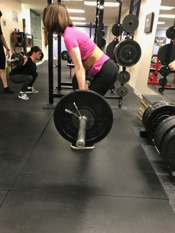 Tina killing some pulls - with some rad squats happening in the background!