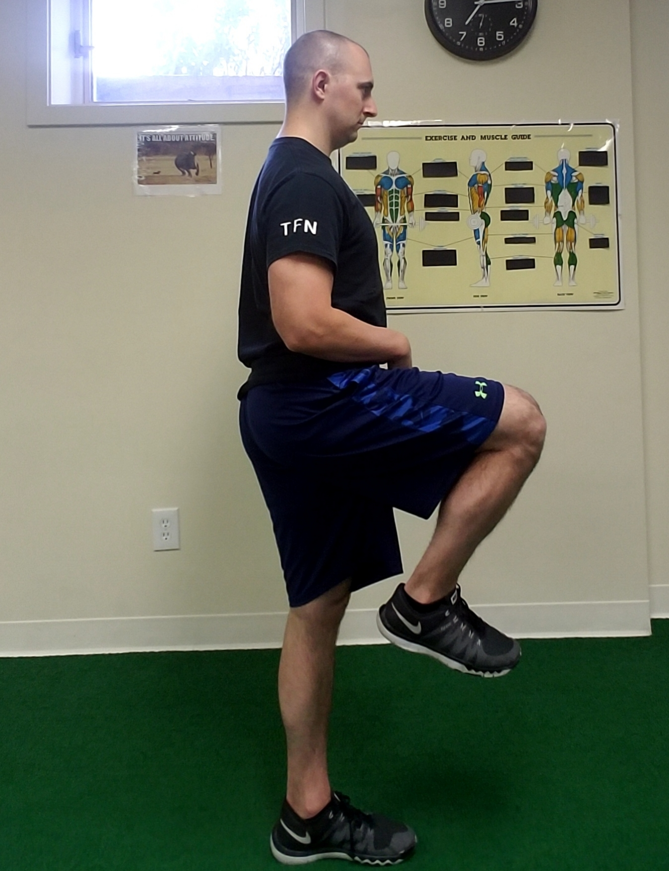 Figure 1.1   As shown in this photo, the spine is extended or arch indicating poor core position. When this occurs the hip cannot flex fully (~90 degrees shown here).