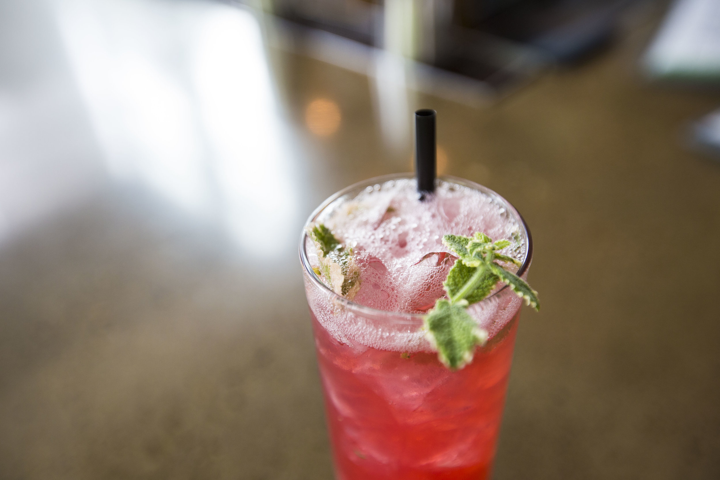 Men in Blackberries cocktail with Tito's vodka, blackberry syrup, lemon and soda water at Graze on July 22, 2016 in Madison, WI.