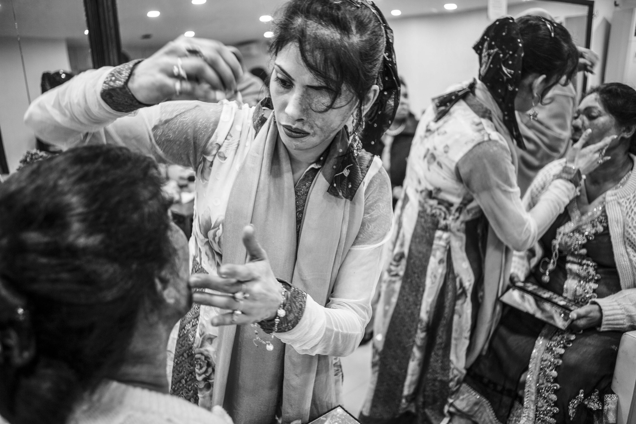 Acid attack survivors Bushra Shafi (Left) gets a makeover by Naureen Jabbar (Right) for the wedding of Sarwari Bibi at Depilex Salon, Jan. 7, 2016 in Lahore, Pakistan.