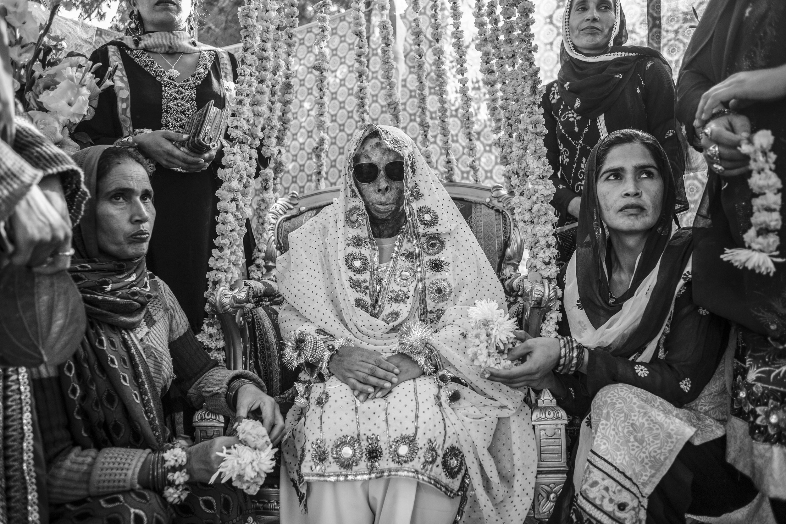 Sarwari Bibi, an acid attack survivor, sits with her sisters at her pre-wedding ceremony on Jan. 7, 2016 in Lahore, Pakistan.