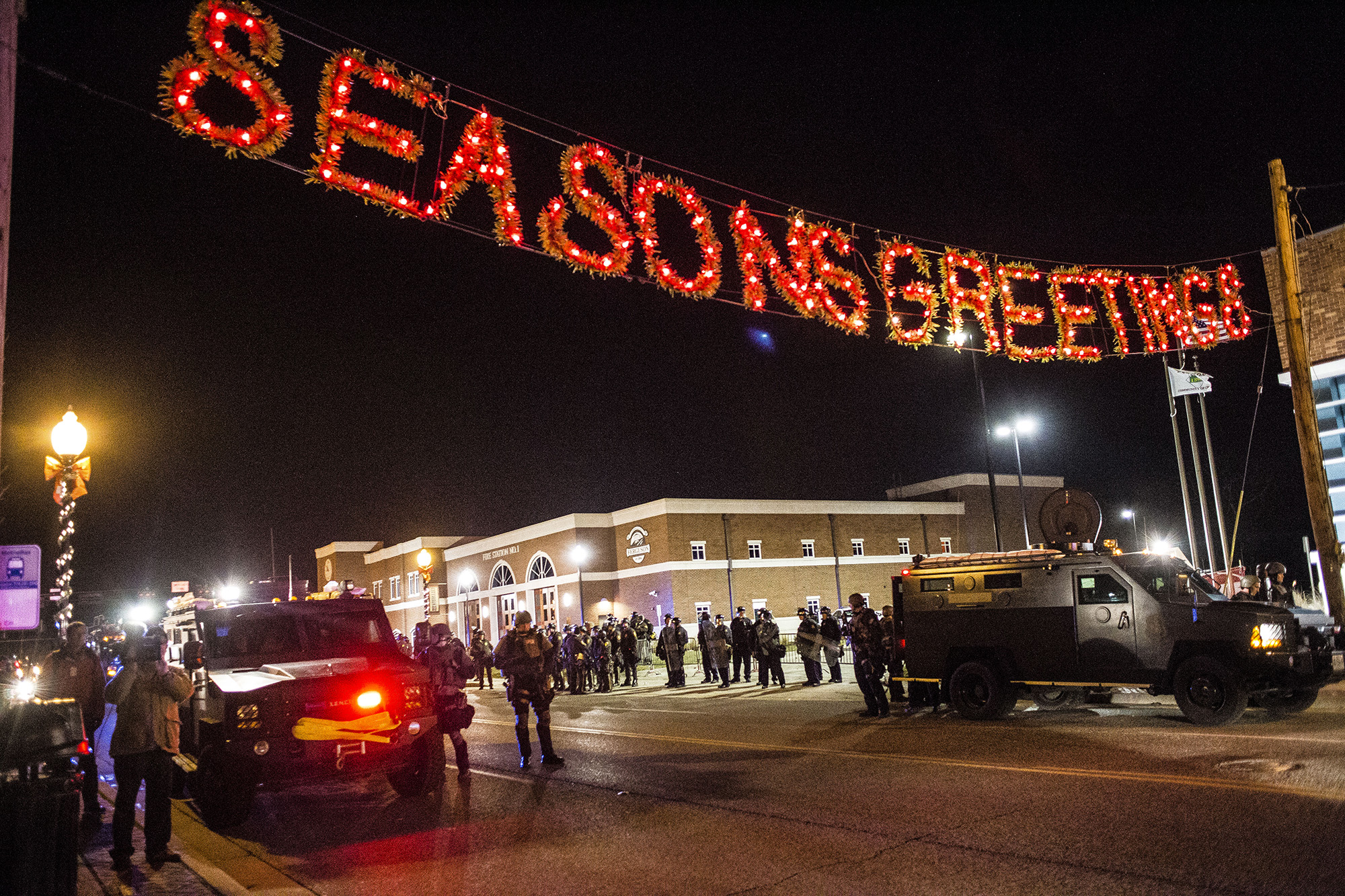 "A ""Season's Greetings"" garland  hangs outside the Ferguson Police Department amid riots on Nov. 25, 2014 in Ferguson, MO."